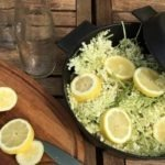 Elder flowers and lemons in a cast iron pot, ready for making elderflower cordial