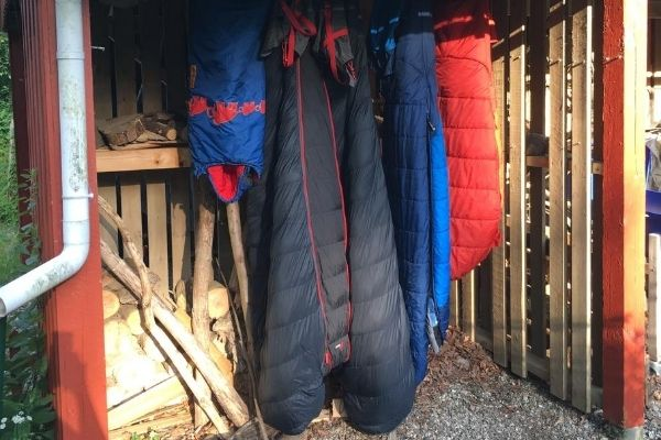 Sleeping bags hanging to dry in a sheltered spot.