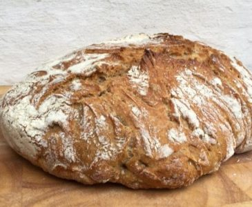 Bread on a wonden board with a white background