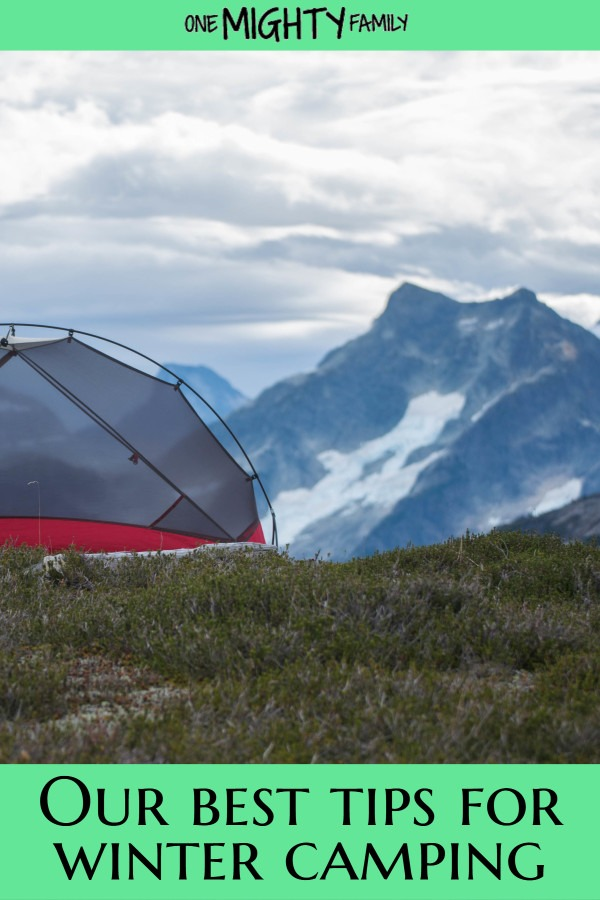 tent overlooking mountains covered in snow - winter tent camping
