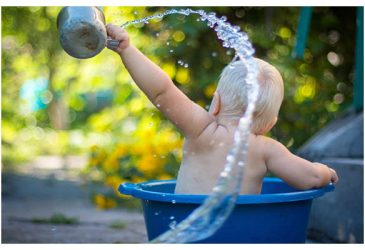 toddler playing with water